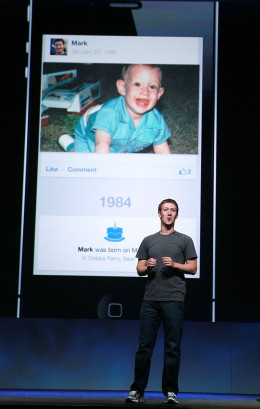 SAN FRANCISCO, CA - SEPTEMBER 22: Facebook CEO Mark Zuckerberg shows a photo of himself as a baby as he delivers a keynote address during the Facebook f8 conference on September 22, 2011 in San Francisco, California. Facebook CEO Mark Zuckerberg kicked off the conference introducing a Timeline feature to the popular social network. (Photo by Justin Sullivan/Getty Images)